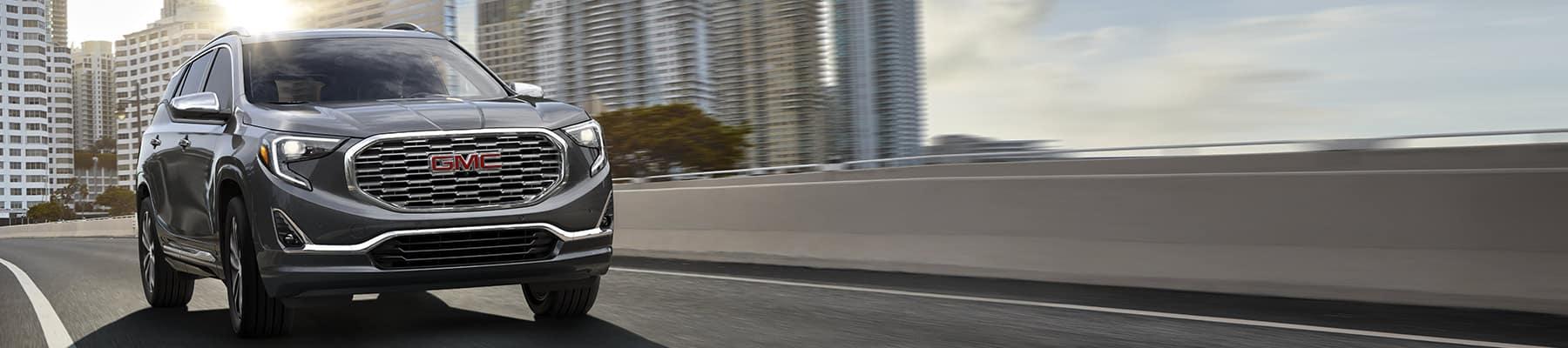 2019 GMC Terrain driving down a road