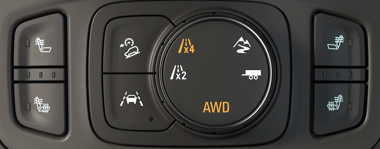 A closeup of the traction and mode controls on a 2019 GMC Terrain