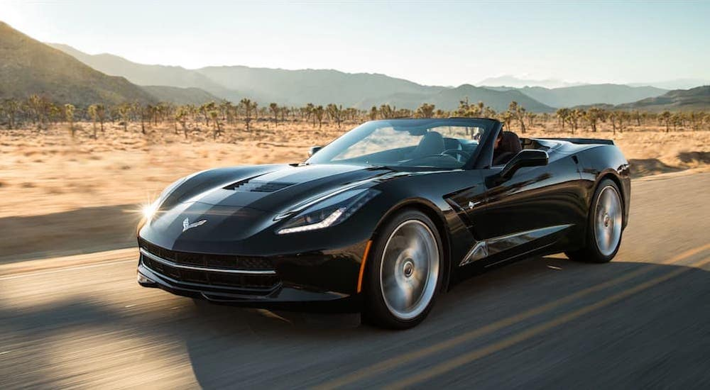 A black 2019 Chevy Corvette Stingray is driving through the desert.