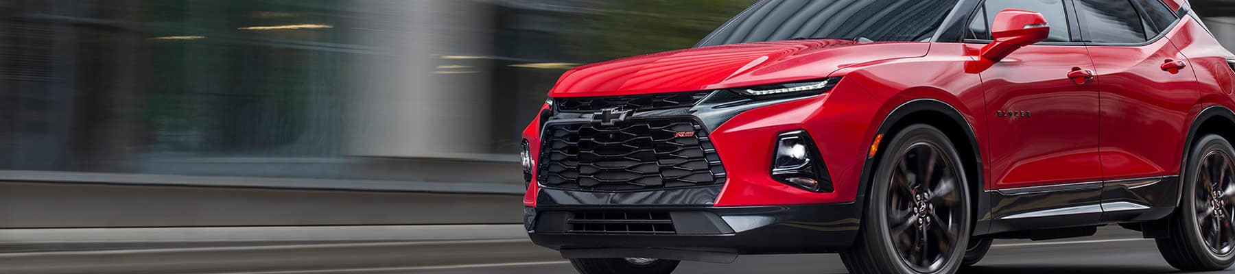 2019 Chevrolet Blazer in Red driving down the road