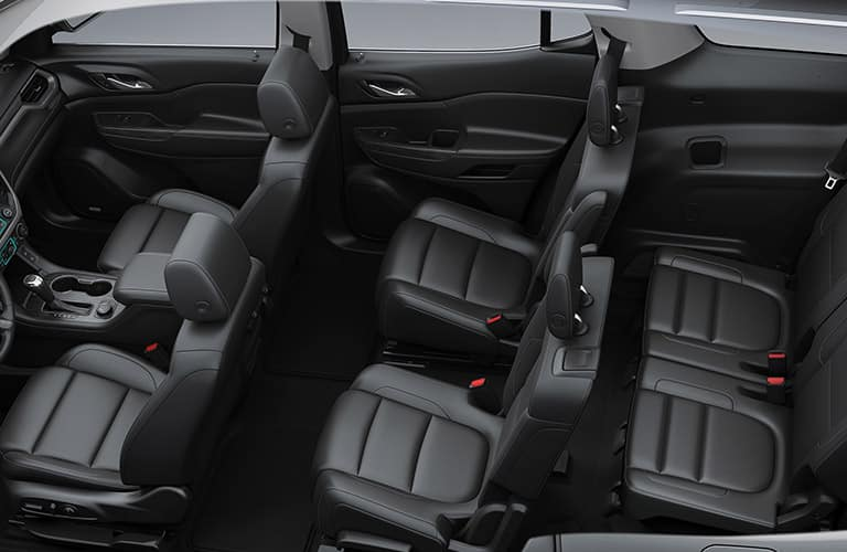 3 rows of black seating inside 2019 GMC Acadia