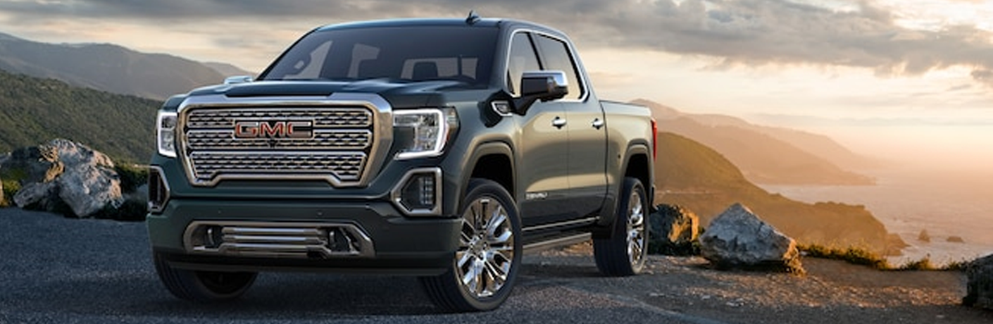 front-side view of 2019 GMC Sierra with sunset in background