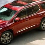 angled view of red 2019 GMC Acadia parked in driveway