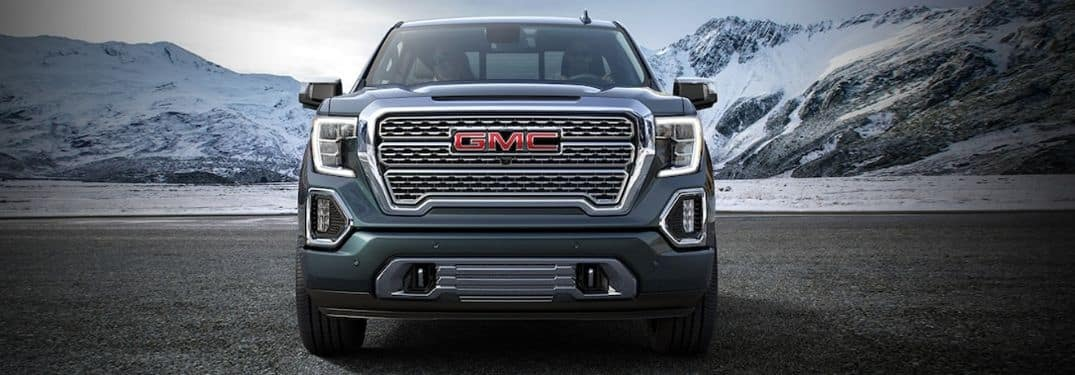 front grille of 2019 GMC Sierra with mountains in background