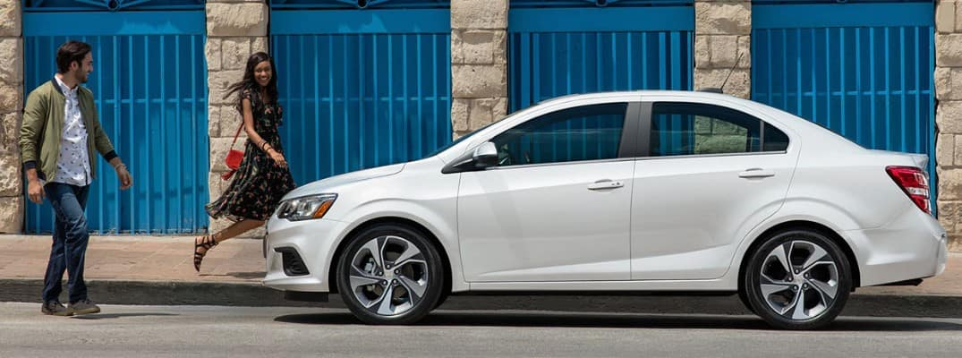 A couple walking out to the 2019 Chevy Sonic