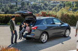 2019 Chevy Equinox with a family spending time in the SUVs trunk at a park