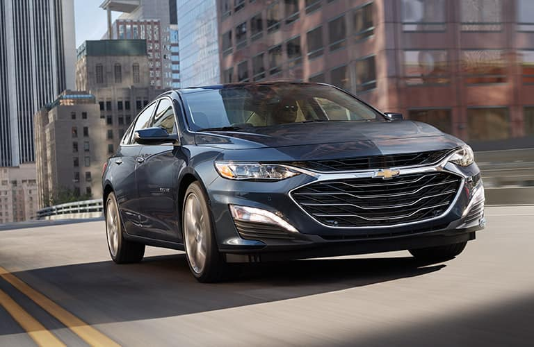 2019 Chevy Malibu driving downtown