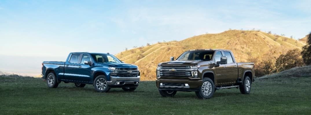 Two, 2020 Chevrolet Silverado 2500HD models parked on the grass