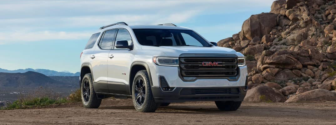 2020 GMC Acadia AT4 parked by a rocky cliff