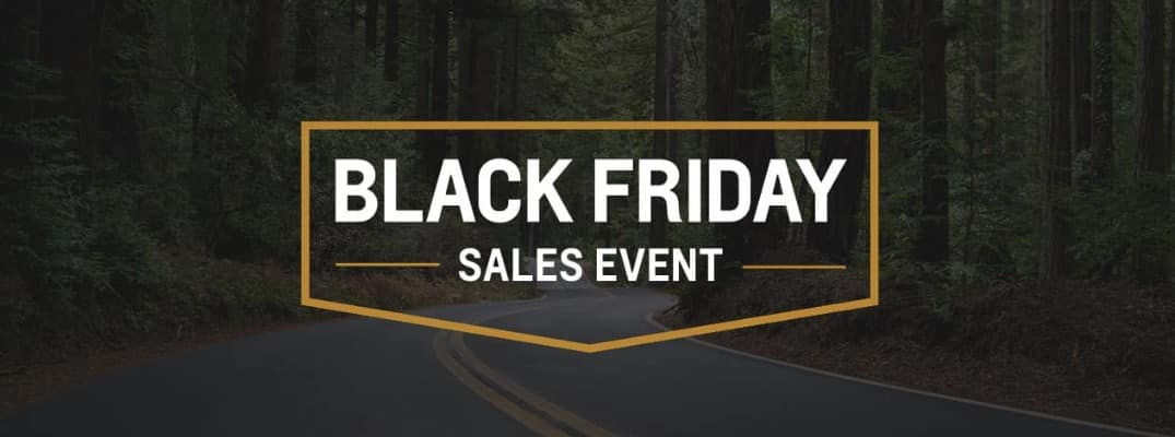 Black Friday Sales Event logo against an image with woods and a road