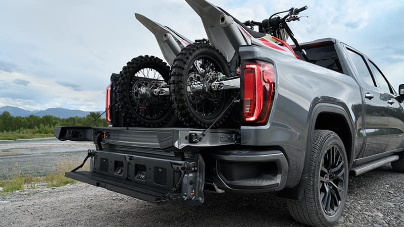 2020 GMC Sierra 1500 Dirtbikes in the truck bed