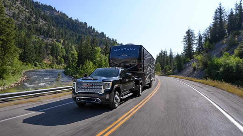 2020 GMC Sierra 3500HD Towing a Camper driving