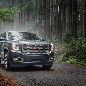 2020 GMC Yukon Denali on wooded road