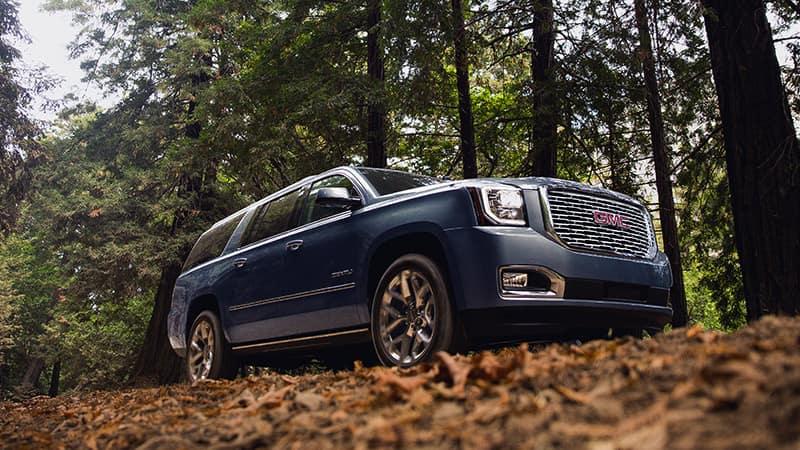 2020 GMC Yukon XL Denali on wooded road