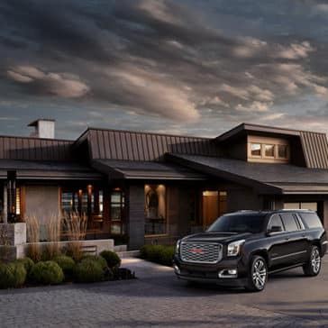 2020 GMC Yukon XL parked at a house