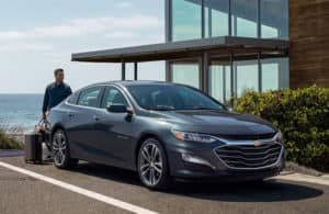 2020 Chevy Malibu in front of a modern home