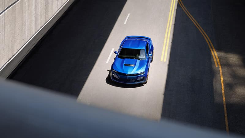 2020 Chevy Camaro Blue Driving Through an Underpass