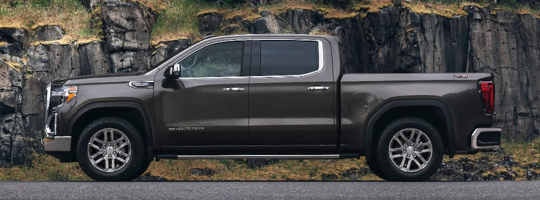 2020 GMC Sierra 1500 with a rock wall behind it