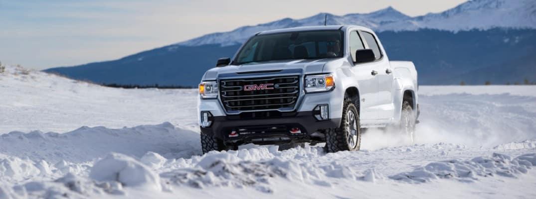 2021 GMC Canyon AT4 driving through snow