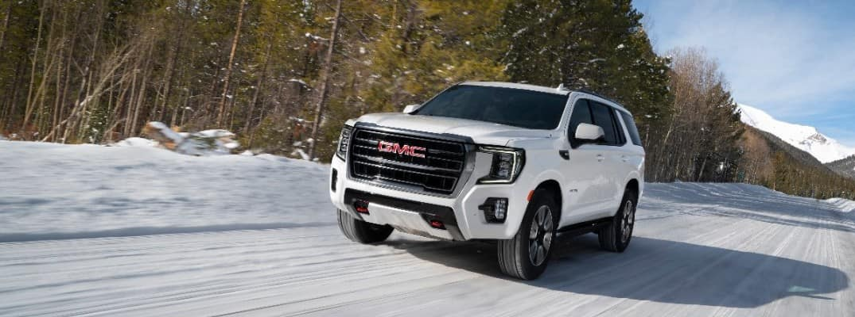 2021 GMC Yukon AT4 driving the snow