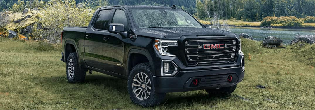 2020 GMC Sierra exterior front fascia passegner side on grass with lake in background