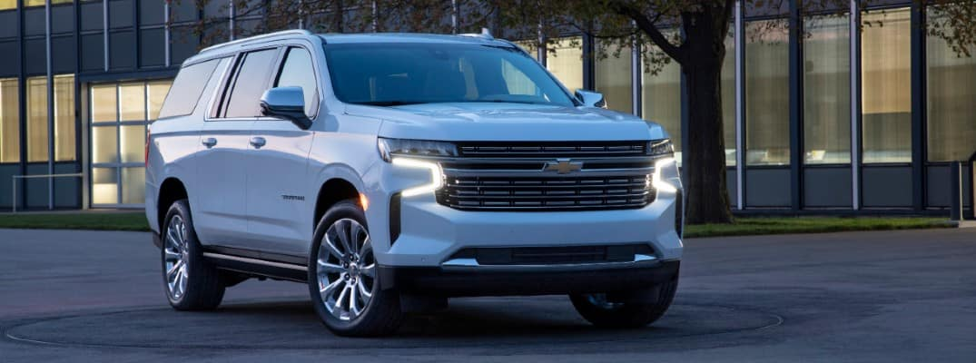 2021 Chevy Suburban parked at night outside a light building
