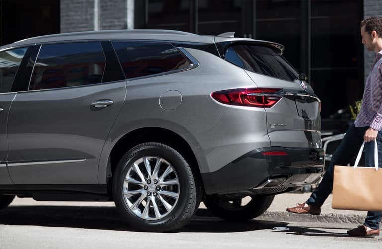 2020 Buick Enclave back end with person holding groceries and opening the hatch with their foot