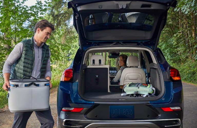 2020 Buick Encore GX with hatch open and man loading up cooler