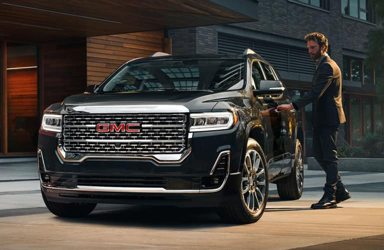 Man getting into the 2020 GMC Acadia Denali