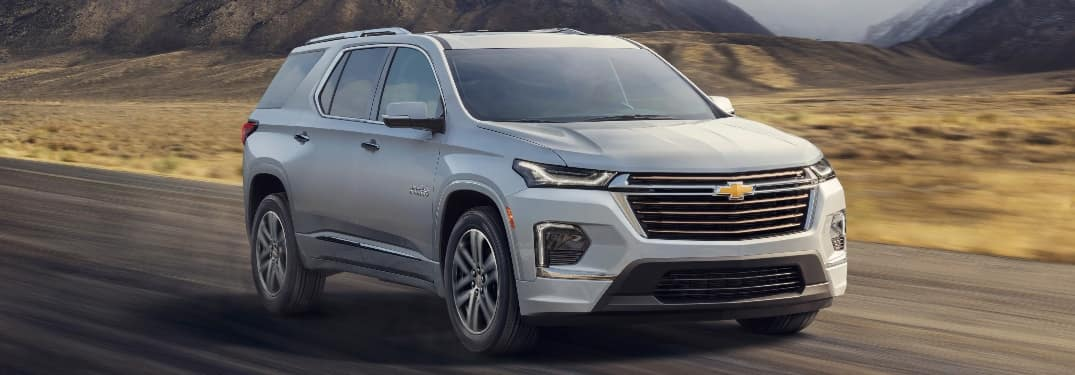 2021 Chevrolet Traverse going down the road will hills in the background