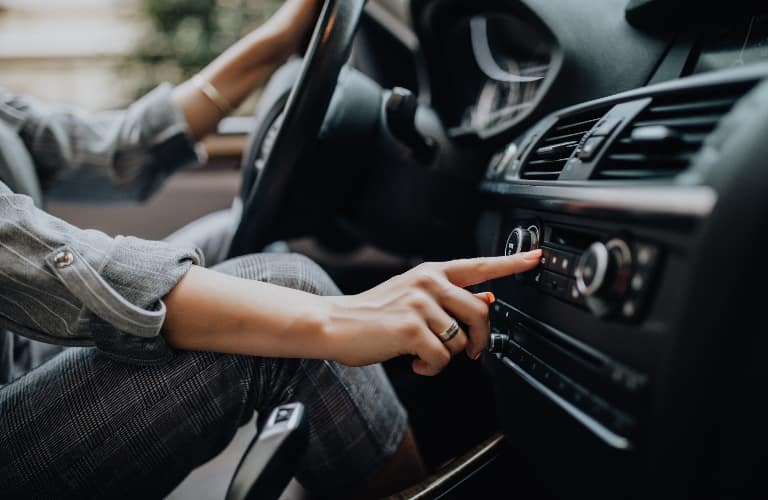 Person pushing a button on the infotainment system