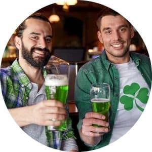 Two men holding green beer