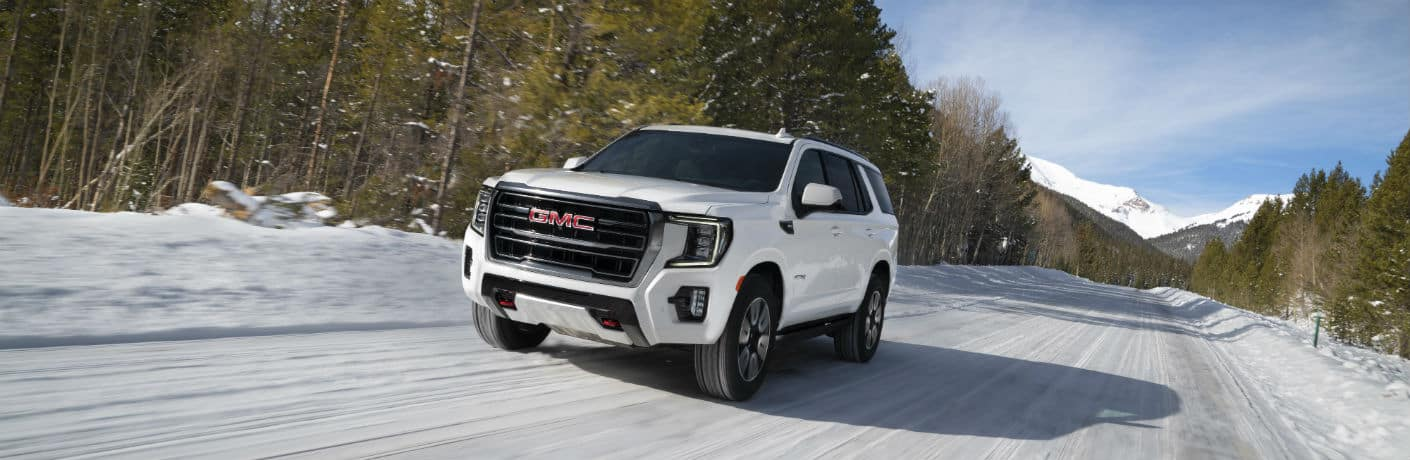 2021 GMC Yukon AT4 driving in the snow
