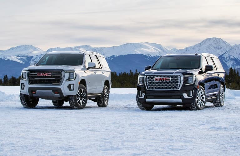 2021 GMC Yukon Denali and AT4 trims next to each other