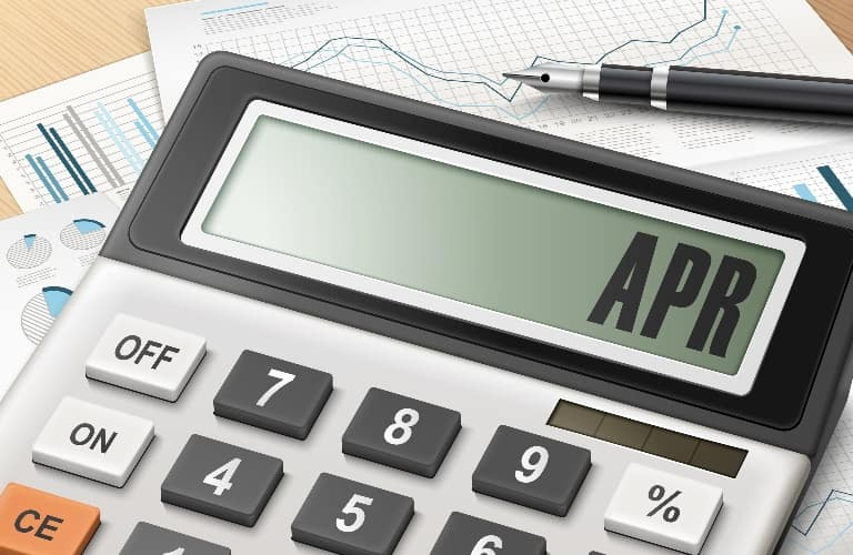 Calculator with the word APR on the screen