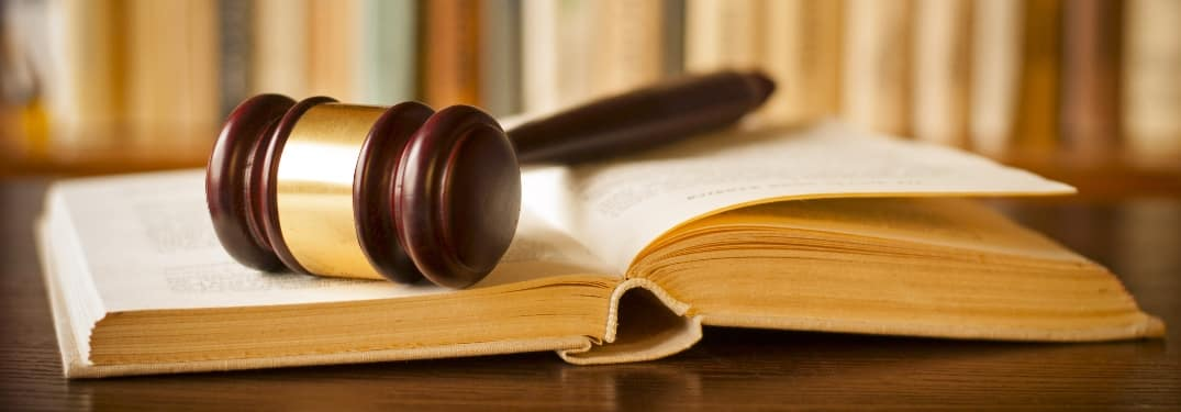 Gavel on top of a law book