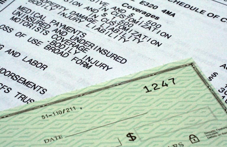 Paperwork and a check for car insurance
