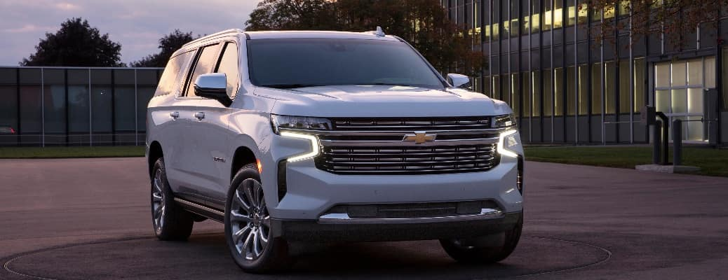 2021 Chevrolet Suburban parked in front of a building with many windows