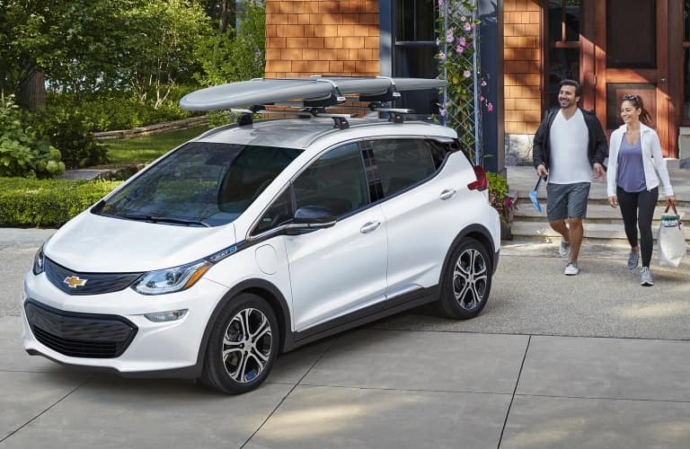Husband and wife heading out on an adventure with their 2020 Chevrolet Bolt