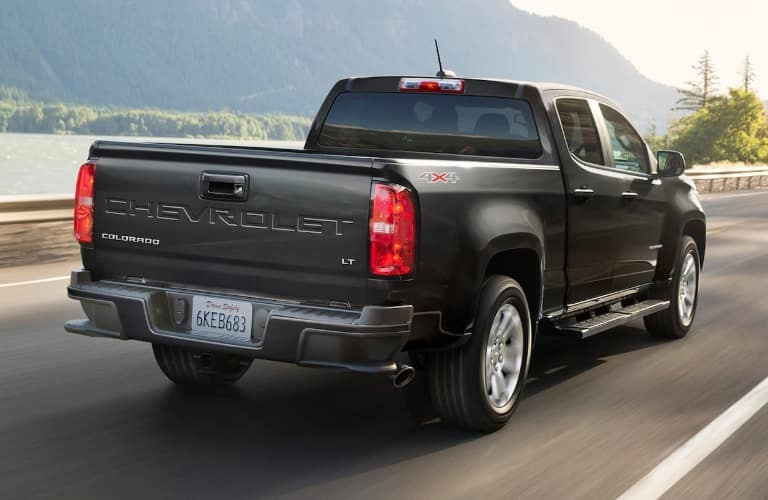 2021 Chevrolet Colorado driving away with hills in the background