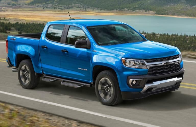 2021 Chevrolet Colorado driving next to a lake