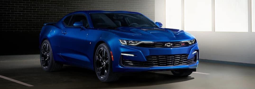 2021 Chevrolet Camaro parked with windows in the background