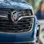 2021 Buick Encore GX front grille with two people at a table in the background