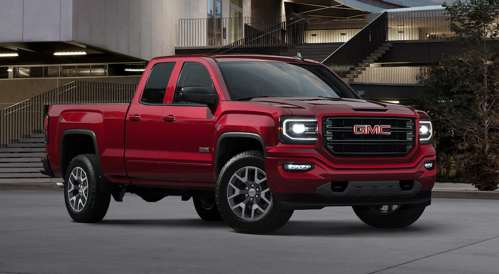 Red 2018 GMC Sierra 1500 in front of building with stairs