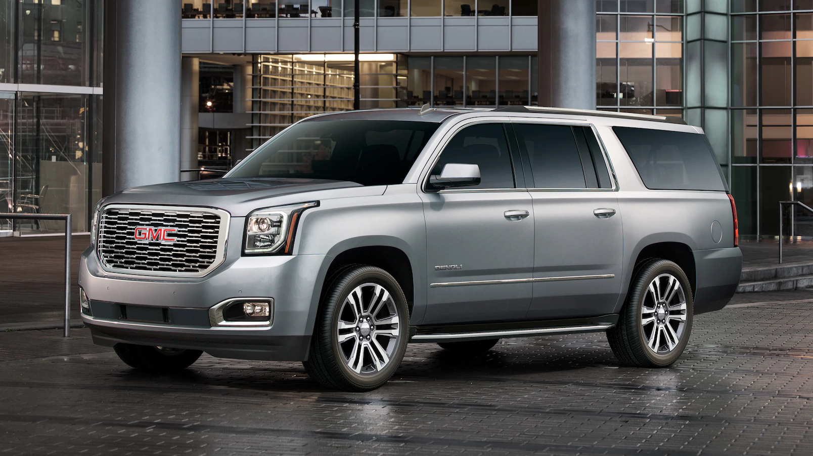 Silver 2019 GMC Yukon in front of glass office