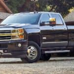 Black 2019 Chevy Silverado HD in front of log cabin
