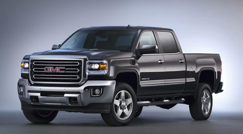 A black 2019 GMC Sierra 2500 sits proudly with blue backlighting