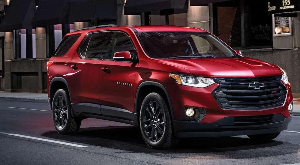 A deep red 2019 Chevy Traverse parked outside an upscale Orlando restaurant