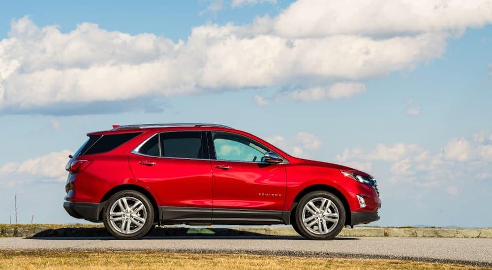 Red 2019 Chevy Equinox against clouded sky