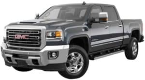 A gray 2019 GMC Sierra 3500 facing left on white